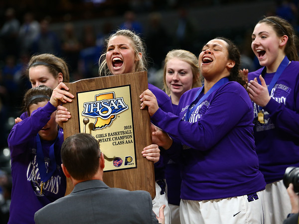 2-24-18<br /> Northwestern wins the 3A state championship against Greensburg 63-42. The Northwestern Tigers celebrate with the state championship trophy.<br /> Kelly Lafferty Gerber | Kokomo Tribune