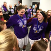 2-24-18<br /> Northwestern wins the 3A state championship against Greensburg 63-42.<br /> From left: Coach Kathie Layden, Kendall Bostic, Stephanie Burns, and Sarah Vas, along with the rest of their teammates, have a group hug in the locker room after their state championship win.<br /> Kelly Lafferty Gerber | Kokomo Tribune