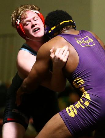 2-3-18<br /> Regional wrestling<br /> Maconaquah's Aaron Sedwick defeats Marion's Victor Lee in the 195.<br /> Kelly Lafferty Gerber | Kokomo Tribune