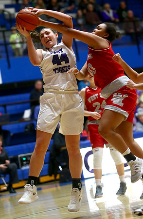 2-3-18<br /> Northwestern vs West Lafayette girls basketball sectional championship<br /> Kendall Bostic is fouled by WL's Itoro Udo-Imeh at the basket.<br /> Kelly Lafferty Gerber | Kokomo Tribune