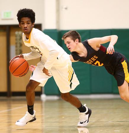 2-13-18<br /> Eastern vs Alexandria boys basketball<br /> Eastern's Greg Black dribbles around Alex's Sam Hensley.<br /> Kelly Lafferty Gerber   Kokomo Tribune