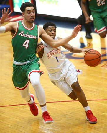 2-16-18<br /> Kokomo vs Anderson boys basketball<br /> Kokomo's Jayveon White tries to dribble by Anderson's Ethen Russell who gets called for a foul.<br /> Kelly Lafferty Gerber | Kokomo Tribune