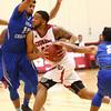 2-21-18<br /> IUK vs Ohio Christian boys basketball<br /> Eddie Miles looks to get past Ohio Christian's defense.<br /> Kelly Lafferty Gerber | Kokomo Tribune