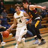 2-13-18<br /> Eastern vs Alexandria boys basketball<br /> Matthew Arcari dribbles down the court.<br /> Kelly Lafferty Gerber | Kokomo Tribune