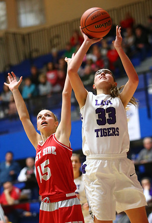 2-3-18<br /> Northwestern vs West Lafayette girls basketball sectional championship<br /> Madison Layden shoots.<br /> Kelly Lafferty Gerber | Kokomo Tribune