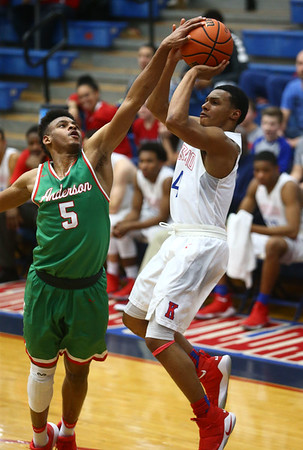 2-16-18<br /> Kokomo vs Anderson boys basketball<br /> Anderson's Marquavius Beverly knocks the ball out of Trajan Deckard's hands as Deckard goes for a shot.<br /> Kelly Lafferty Gerber | Kokomo Tribune