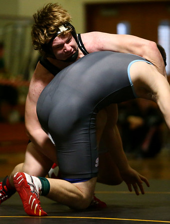 2-3-18<br /> Regional wrestling<br /> Western's Braydon Erb takes down Maconaquah's Collin Silvers in the 220.<br /> Kelly Lafferty Gerber | Kokomo Tribune