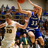 2-6-18<br /> Eastern vs Tipton boys basketball<br /> Tipton's Trent Seward is fouled by Eastern's Draeden Morris-Graber.<br /> Kelly Lafferty Gerber | Kokomo Tribune