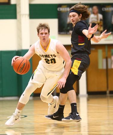 2-13-18<br /> Eastern vs Alexandria boys basketball<br /> Draeden Morris-Graber dribbles down the court.<br /> Kelly Lafferty Gerber | Kokomo Tribune