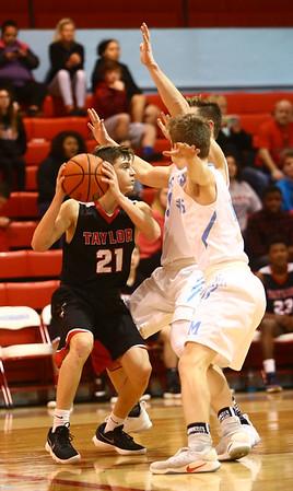 2-20-18<br /> Maconaquah vs Taylor boys basketball<br /> Wynn Takacs looks for a pass over Mac's defense.<br /> Kelly Lafferty Gerber | Kokomo Tribune
