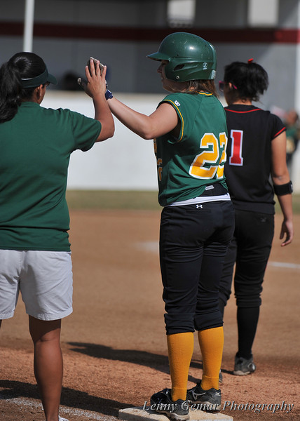Coach Ana Landeros welcomes Griffin #22 to 1st base.