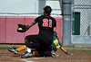 Griffin #22 slides into home plate. Is she safe?...