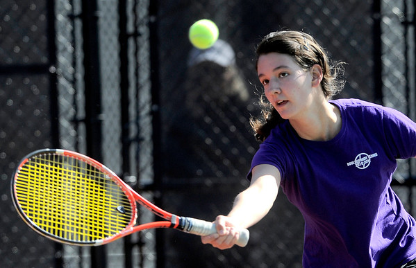 Boulder's Miquela Newhart returns the ball during her match against Palmer's Adriana Wojakowska in the 2011 5A State Tennis at the Gates Tennis Center in Denver, Colorado May 13, 2011.  CAMERA/Mark Leffingwell