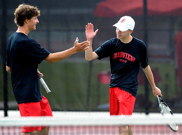 "Nick Blanco, left, of Fairview, and his  partner, Ben Krahenbuhl, won the match in  #4 doubles against Cherry Creek.<br /> For more photos of state tennis, go to  <a href=""http://www.dailycamera.com"">http://www.dailycamera.com</a>.<br /> Cliff Grassmick / October 15, 2011"