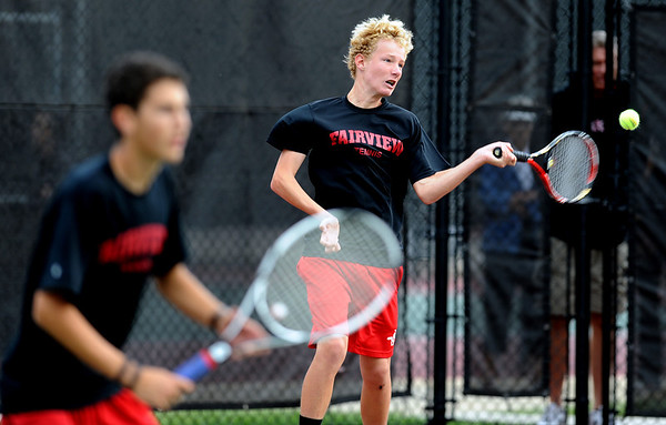 """Andrew Pollack, left,  of Fairview, plays in the #3 doubles match with Tommy Mason, hitting against Cherry Creek.<br /> For more photos of state tennis, go to  <a href=""""http://www.dailycamera.com"""">http://www.dailycamera.com</a>.<br /> Cliff Grassmick / October 15, 2011"""