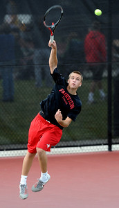 Johnny Combs of Fairview plays in the #2 singles match against  Zach Fryer of Cherry Creek. For more photos of state tennis, go to www.dailycamera.com. Cliff Grassmick / October 15, 2011