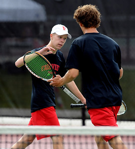 Ben Krahenbuhl, left, of Fairview, and his  partner, Nick Blanco, won the match in  #4 doubles against Cherry Creek. For more photos of state tennis, go to www.dailycamera.com. Cliff Grassmick / October 15, 2011
