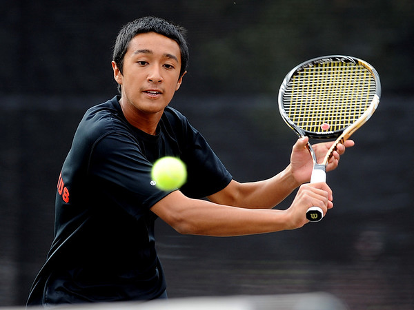 "Igantius Castelino of Fairview plays against Daniel Steinhauser of Cherry Creek in the #3 singles.<br /> For more photos of state tennis, go to  <a href=""http://www.dailycamera.com"">http://www.dailycamera.com</a>.<br /> Cliff Grassmick / October 15, 2011"