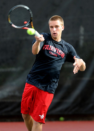 "Johnny Combs of Fairview plays in the #2 singles match against  Zach Fryer of Cherry Creek.<br /> For more photos of state tennis, go to  <a href=""http://www.dailycamera.com"">http://www.dailycamera.com</a>.<br /> Cliff Grassmick / October 15, 2011"