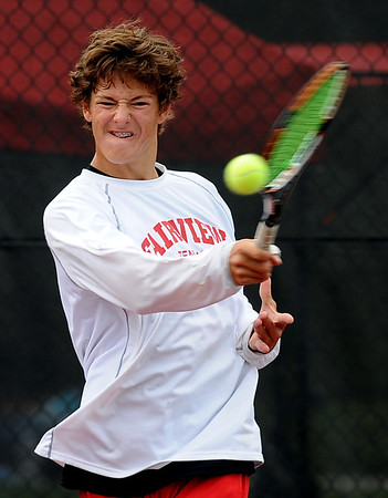 "Nick Blanco of Fairview, returns a shot in the #4 double match. He and his  partner, Ben Krahenbuhl, won the match against Cherry Creek.<br /> For more photos of state tennis, go to  <a href=""http://www.dailycamera.com"">http://www.dailycamera.com</a>.<br /> Cliff Grassmick / October 15, 2011"