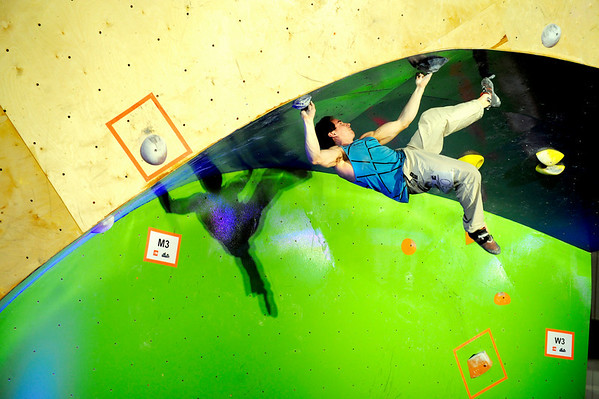 """Boulder climber Carlo Traversi shows his bouldering skills on Saturday, Feb. 12, at the 2011 ABS 12 National Championships at 3550 Frontier Ave. in Boulder. For more photos and a video of the event go to  <a href=""""http://www.dailycamera.com"""">http://www.dailycamera.com</a><br /> Jeremy Papasso/ Camera"""