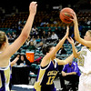 "Monarch High School sophomore Brenna Stimac, right, passes the ball to a teammate on Friday, March 4, in a game against Fort Collins High School during the Colorado High School ""Great 8"" tournament at the Denver Coliseum. Monarch lost the game 44-45. For more photos go to  <a href=""http://www.dailycamera.com"">http://www.dailycamera.com</a><br /> Jeremy Papasso/ Camera"
