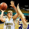 "Monarch High School senior Mattie Stanford drives to past Ft. Collins senior Alexus Lopez on Friday, March 4, in a game against Fort Collins High School during the Colorado High School ""Great 8"" tournament at the Denver Coliseum. Monarch lost the game 44-45. For more photos go to  <a href=""http://www.dailycamera.com"">http://www.dailycamera.com</a><br /> Jeremy Papasso/ Camera"