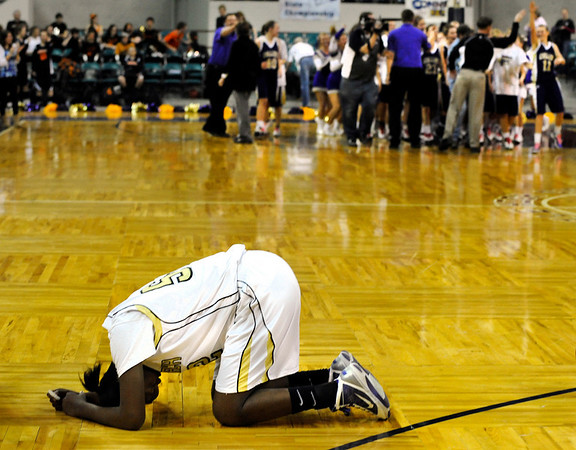 """Monarch High School junior Alexis Johnson, left, shows her emotion after losing to Fort Collins 44-55 on Friday, March 4, during the Colorado High School """"Great 8"""" tournament at the Denver Coliseum. For more photos go to  <a href=""""http://www.dailycamera.com"""">http://www.dailycamera.com</a><br /> Jeremy Papasso/ Camera"""