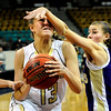 "Monarch High School junior Ashton Davis gets fouled by Fort Collins junior Nicole McAuliffe as she drives towards the basket on Friday, March 4, in a game against Fort Collins High School during the Colorado High School ""Great 8"" tournament at the Denver Coliseum. Monarch lost the game 44-45. For more photos go to  <a href=""http://www.dailycamera.com"">http://www.dailycamera.com</a><br /> Jeremy Papasso/ Camera"