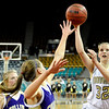 "Monarch High School senior Katie O'Brien takes a shot over Fort Collins defenders on Friday, March 4, in a game against Fort Collins High School during the Colorado High School ""Great 8"" tournament at the Denver Coliseum. Monarch lost the game 44-45. For more photos go to  <a href=""http://www.dailycamera.com"">http://www.dailycamera.com</a><br /> Jeremy Papasso/ Camera"