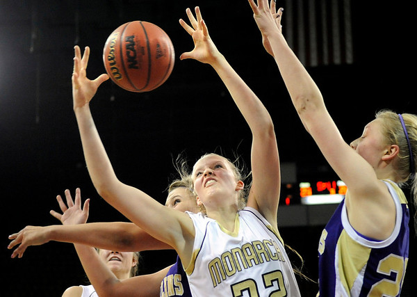 "Monarch High School senior Katie O'Brien grabs a rebound on Friday, March 4, in a game against Fort Collins High School during the Colorado High School ""Great 8"" tournament at the Denver Coliseum. Monarch lost the game 44-45. For more photos go to  <a href=""http://www.dailycamera.com"">http://www.dailycamera.com</a><br /> Jeremy Papasso/ Camera"
