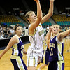 "Monarch High School junior Ashton Davis shoots the ball over Fort Collins junior Nicole McAuliffe on Friday, March 4, in a game against Fort Collins High School during the Colorado High School ""Great 8"" tournament at the Denver Coliseum. Monarch lost the game 44-45. For more photos go to  <a href=""http://www.dailycamera.com"">http://www.dailycamera.com</a><br /> Jeremy Papasso/ Camera"