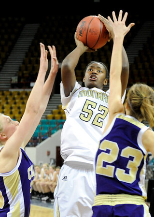 """Monarch High School junior Alexus Johnson takes a shot over Fort Collins junior Rachael Rudel on Friday, March 4, in a game against Fort Collins High School during the Colorado High School """"Great 8"""" tournament at the Denver Coliseum. Monarch lost the game 44-45. For more photos go to  <a href=""""http://www.dailycamera.com"""">http://www.dailycamera.com</a><br /> Jeremy Papasso/ Camera"""