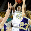 "Monarch High School junior Alexus Johnson takes a shot over Fort Collins junior Rachael Rudel on Friday, March 4, in a game against Fort Collins High School during the Colorado High School ""Great 8"" tournament at the Denver Coliseum. Monarch lost the game 44-45. For more photos go to  <a href=""http://www.dailycamera.com"">http://www.dailycamera.com</a><br /> Jeremy Papasso/ Camera"