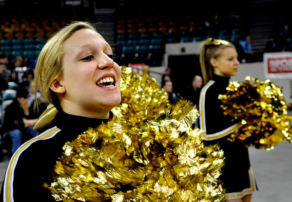 "Monarch High School senior Ally Conis, left, cheers for Monarch with the rest of her cheer squad on Friday, March 4, in a game against Fort Collins High School during the Colorado High School ""Great 8"" tournament at the Denver Coliseum. Monarch lost the game 44-45. For more photos go to  <a href=""http://www.dailycamera.com"">http://www.dailycamera.com</a><br /> Jeremy Papasso/ Camera"