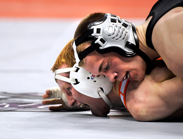 Erie High School wrestler Clay Bunker struggles to escape the grasp of Discovery Canyon's Nick Adams in the 140-pound semi-final match on Friday, Feb. 18, during the 2011 Colorado High School Class 4A State Wrestling Tournament at the Pepsi Center in Denver. Bunker lost the match.<br /> Photo by Jeremy Papasso