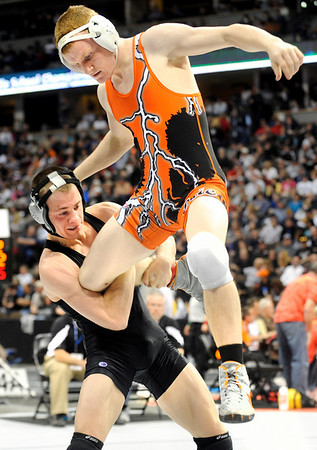 Erie High School wrestler Clay Bunker avoids a takedown attempt from Discovery Canyon's Nick Adams in the 140-pound semi-final match on Friday, Feb. 18, during the 2011 Colorado High School Class 4A State Wrestling Tournament at the Pepsi Center in Denver. Bunker lost the match.<br /> Photo by Jeremy Papasso