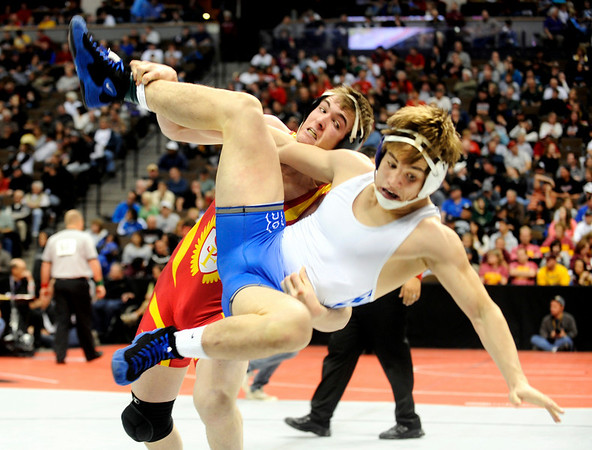 Skyline High School wrestler Josh Bechtold goes for a takedown on Broomfield High School's Connor King in a 171-pound semi-final match on Friday, Feb. 18, during the 2011 Colorado High School Class 4A State Wrestling Tournament at the Pepsi Center in Denver. Bechtold lost  the match to advance to the finals.<br /> Photo by Jeremy Papasso