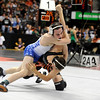 Broomfield High School wrestler Phil Downing goes for a takedown on Montezuma-Cortez's Ryan Daves in a 119-pound semi-final match on Friday, Feb. 18, during the 2011 Colorado High School Class 4A State Wrestling Tournament at the Pepsi Center in Denver. <br /> Photo by Jeremy Papasso