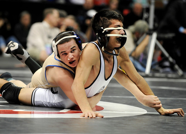 "Broomfield High School wrestler Phil Downing, left, looks up at the clock while wrestling Pueblo South's Timothy Urenda during the Colorado State Class 4A 119-pound championship match on Saturday, Feb. 19, at the Pepsi Center in Denver. Downing won the match. For more photos go to  <a href=""http://www.dailycamera.com"">http://www.dailycamera.com</a><br /> Photo by Jeremy Papasso"