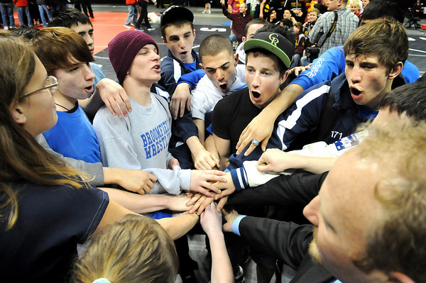 "The Broomfield High School wrestlers Connor King, upper right, Nick Babcock, and Cortland Hacker, red hat, join their team to celebrate after the finals of the Colorado State Championship on Saturday, Feb. 19, at the Pepsi Center in Denver. For more photos go to  <a href=""http://www.dailycamera.com"">http://www.dailycamera.com</a><br /> Photo by Jeremy Papasso"