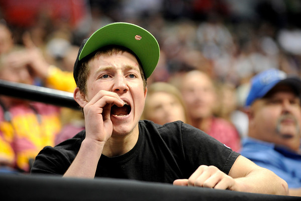 "Broomfield High School wrestler Nick Babcock cheers for his teammate Cortland Hacker during the Colorado State Class 4A 125-pound championship match on Saturday, Feb. 19, at the Pepsi Center in Denver. Hacker lost the match. For more photos go to  <a href=""http://www.dailycamera.com"">http://www.dailycamera.com</a><br /> Photo by Jeremy Papasso"