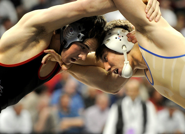 "Broomfield High School's Connor King ties up with Montrose High Schools Bryce Gaber during the Colorado State Class 4A 171-pound championship match on Saturday, Feb. 19, at the Pepsi Center in Denver. King took 1st place in the state. For more photos go to  <a href=""http://www.dailycamera.com"">http://www.dailycamera.com</a><br /> Photo by Jeremy Papasso"