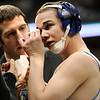"Broomfield High School wrestler Phil Downing, right, wipes blood from his face with the help of Head Coach Joe Pereira during the Colorado State Class 4A 119-pound championship match on Saturday, Feb. 19, at the Pepsi Center in Denver. Downing won the match. For more photos go to  <a href=""http://www.dailycamera.com"">http://www.dailycamera.com</a><br /> Photo by Jeremy Papasso"