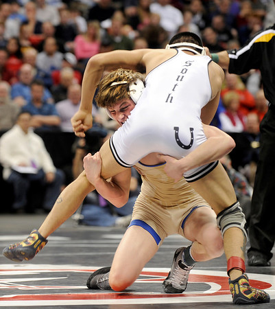 Broomfield High School wrestler Cortland Hacker goes for a takedown on Pueblo South's Robert DeHerrera during the Colorado State Class 4A 125-pound championship match on Saturday, Feb. 19, at the Pepsi Center in Denver. Hacker lost the match and took 2nd place.<br /> Photo by Jeremy Papasso