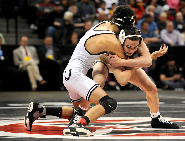 "Broomfield High School wrestler Phil Downing, right, grapples with Pueblo South's Timothy Urenda  during the Colorado State Class 4A 119-pound championship match on Saturday, Feb. 19, at the Pepsi Center in Denver. Downing won the match. For more photos go to  <a href=""http://www.dailycamera.com"">http://www.dailycamera.com</a><br /> Photo by Jeremy Papasso"