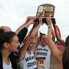"Kaitlyn Benner, left, and Anna Hogan (759) of Monarch High, hold up the 5A State Championship trophy.<br /> For more photos of state, go to  <a href=""http://www.dailycamera.com"">http://www.dailycamera.com</a>.<br /> Cliff Grassmick / October 29, 2011"