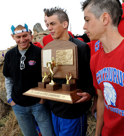 "Chandler Reid of Centaurus holds the 4A State Championship trophy while surrounded by teammates.<br /> For more photos of state, go to  <a href=""http://www.dailycamera.com"">http://www.dailycamera.com</a>.<br /> Cliff Grassmick / October 29, 2011"