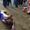 "Emma Merryman, left, and Sam Lewis, both of Boulder High, collapse on the ground after finishing in the 5A  girls race.<br /> For more photos of state, go to  <a href=""http://www.dailycamera.com"">http://www.dailycamera.com</a>.<br /> Cliff Grassmick / October 29, 2011"