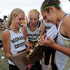 "Kaitlyn Benner, left, Karina Mann, and Anna Hogan all, of Monarch High, apparently can't believe they just won the 5A Colorado State Championship.<br /> For more photos of state, go to  <a href=""http://www.dailycamera.com"">http://www.dailycamera.com</a>.<br /> Cliff Grassmick / October 29, 2011"